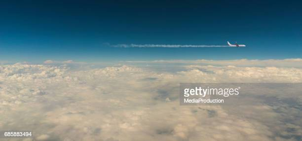 airplane above clouds with copyspace - aeroplane stock pictures, royalty-free photos & images