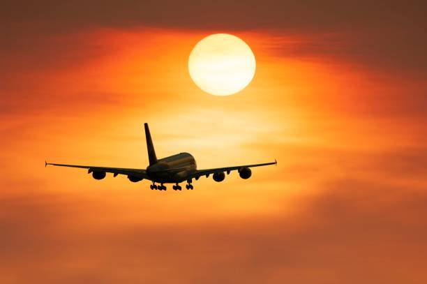 PHOTOMONTAGE, airplane after takeoff, sunset, Baden-Wuerttemberg, Germany