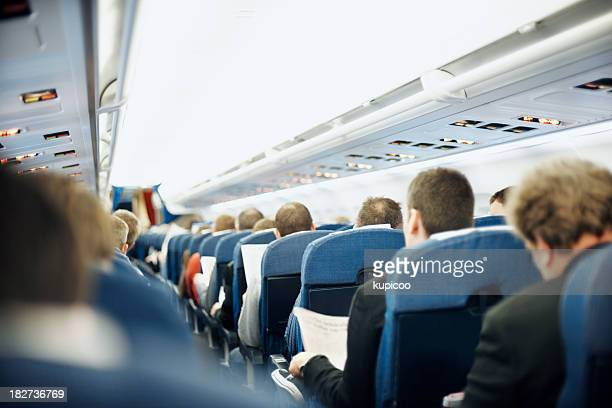 Airplane aisle with group of passengers