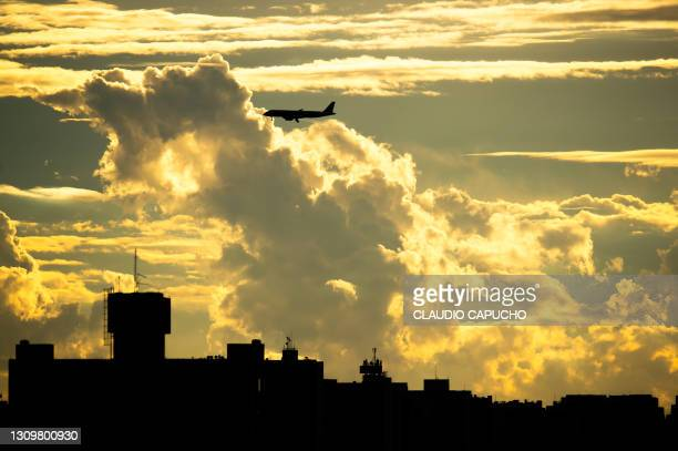 airplane among clouds - claudio capucho stock pictures, royalty-free photos & images