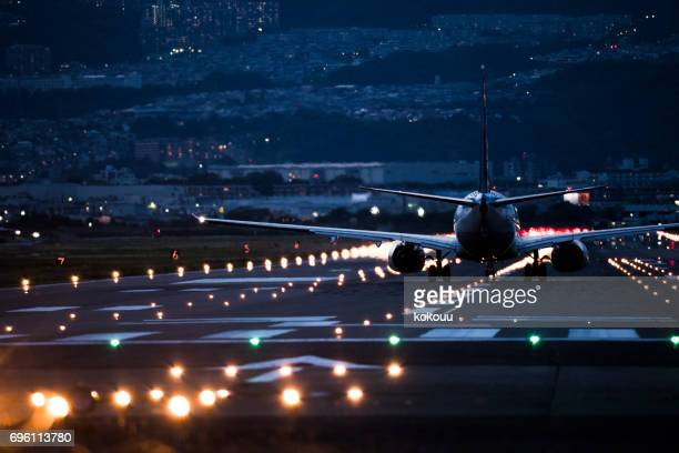 Airplane and airport and light.