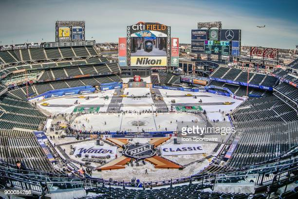 Airplane approaches nearby LaGuardia Airport during Sabres practice for the the New York Rangers and Buffalo Sabres Winter Classic NHL game on...