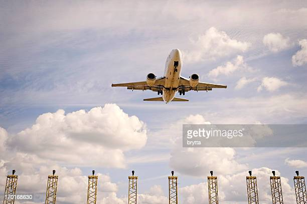 airplane approaching runway with landing lights , brussels airport, steenokkerzeel, belgium. - zaventem airport stock pictures, royalty-free photos & images