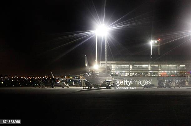 airplane at gate at night in the airport