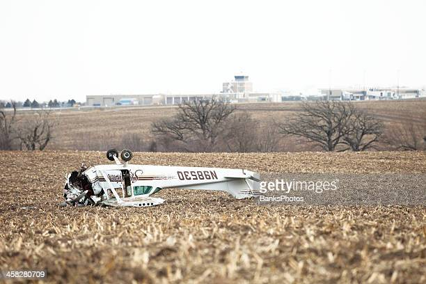 Airplane Crash on Farm Field with Airport Background