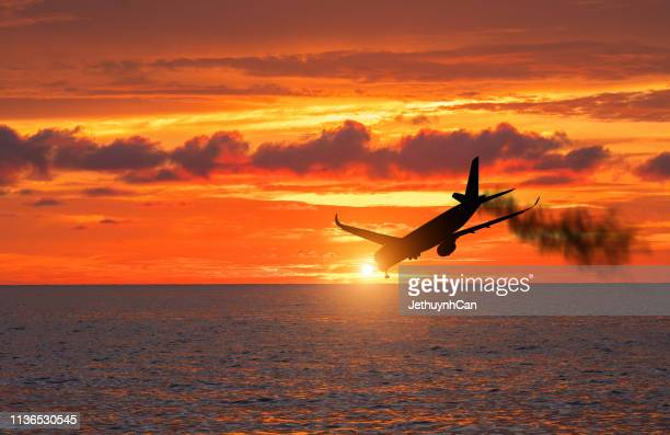 airplane crash silhouette - airplane crash stock pictures, royalty-free photos & images