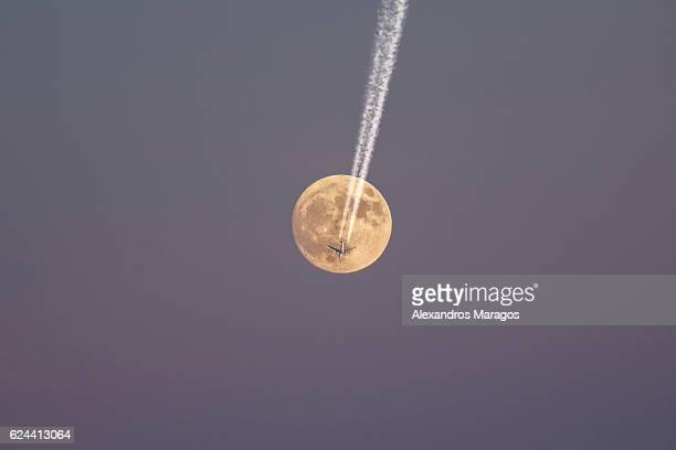 Airplane crossing the Supermoon