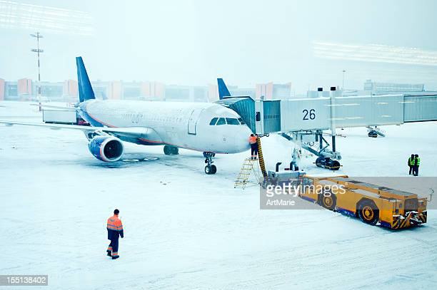 Airplane de-iced after snowstorm