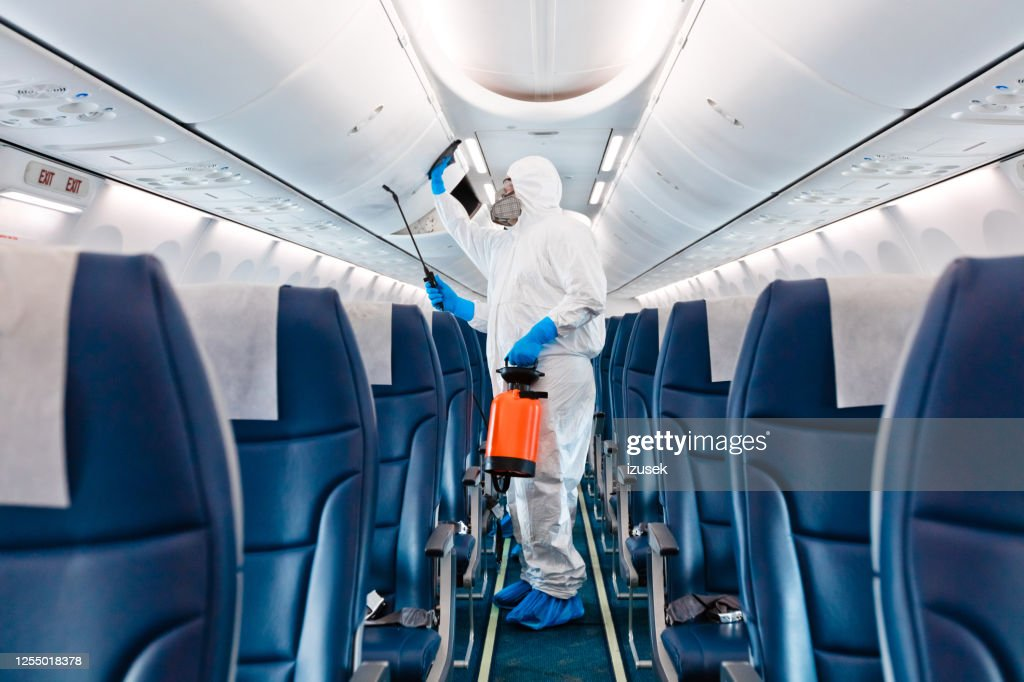 Airplane disinfection due to COVID-19 : Stock Photo