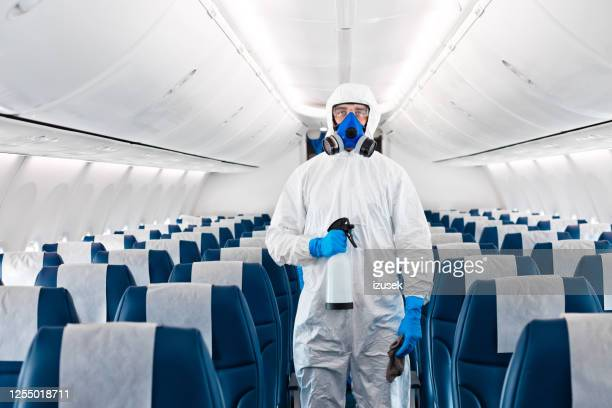 airplane disinfection due to covid-19 - airplane stock pictures, royalty-free photos & images