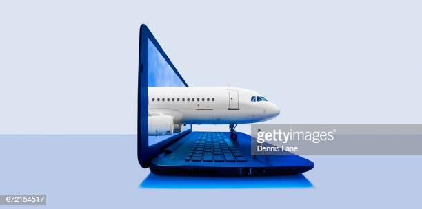 Airplane emerging from laptop screen with pilot walking on keyboard