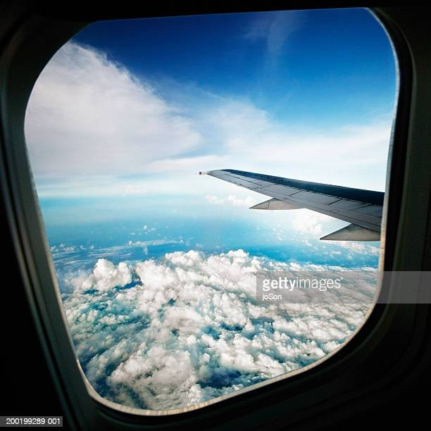 Airplane flying above clouds, view from interior