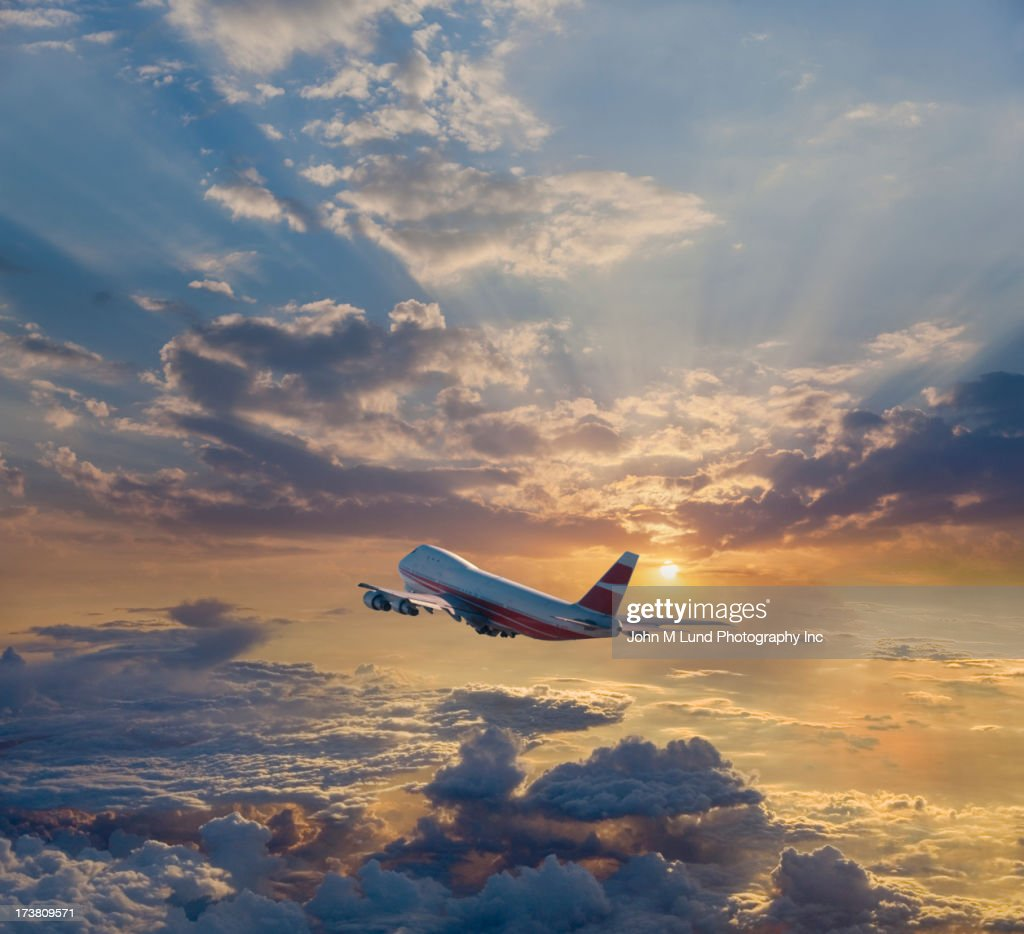 Airplane flying in dramatic sky : Stock Photo