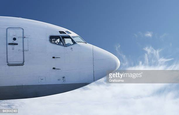 Airplane flying in front of blue sky