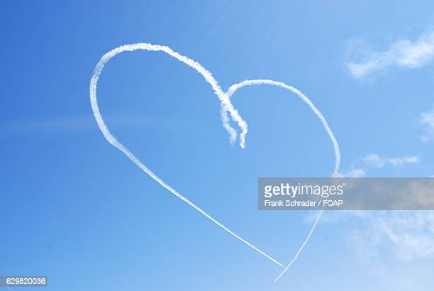 Airplane flying in shape of a heart