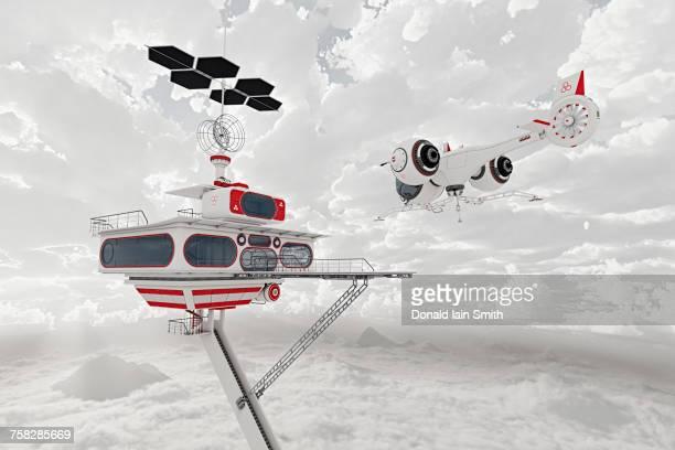 Airplane flying near futuristic platform in clouds