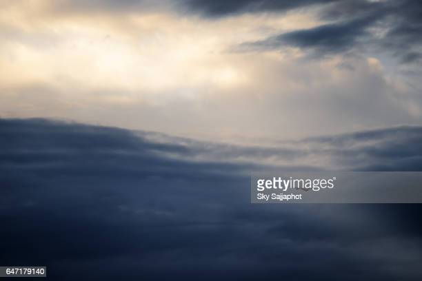Airplane flying on the blue sky cloud with sun rays