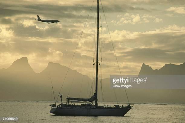 airplane flying over a sailboat, moorea, tahiti, society islands, french polynesia - pacific islands stock pictures, royalty-free photos & images