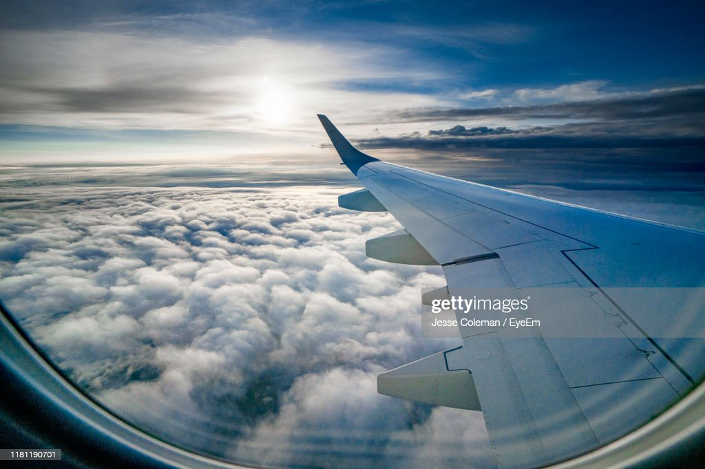 Airplane Flying Over Cloudscape Against Sky : Foto de stock