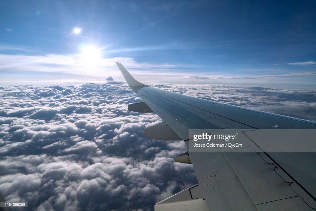 Airplane Flying Over Cloudscape Against Sky : Stock Photo