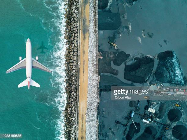 airplane flying over coal mineral exploitation - pollution stock pictures, royalty-free photos & images