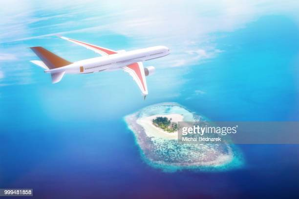 Airplane flying over Maldives islands on Indian Ocean. Travel