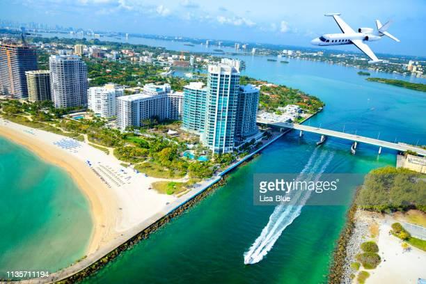 airplane flying over miami beach, florida, usa. - miami stock pictures, royalty-free photos & images