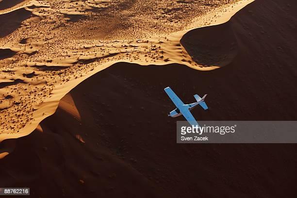 Airplane flying over sand dunes, Sossusvlei, Namib desert, Namibia