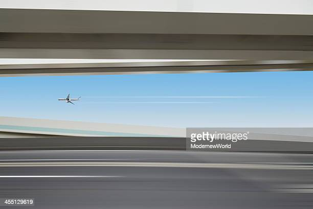 airplane flying over the highway