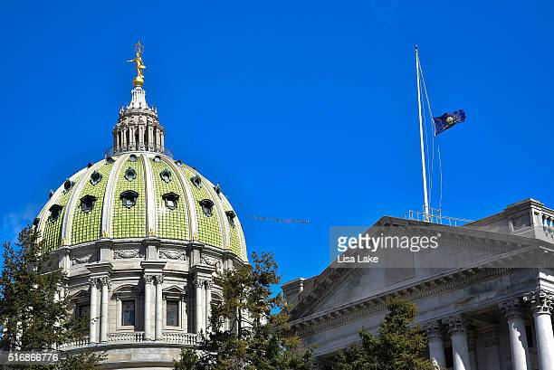Airplane flys over PA State Capitol Building with a banner reading SEN TOOMEY DO YOUR JOB #FILLTHESEAT during National Day Of Action calling on...