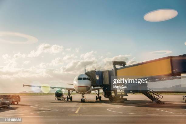 airplane in an airport - passenger boarding bridge stock pictures, royalty-free photos & images