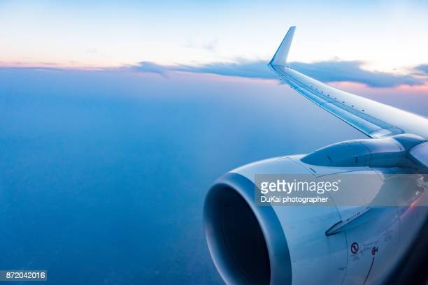 airplane in flight - aeroplane stock pictures, royalty-free photos & images