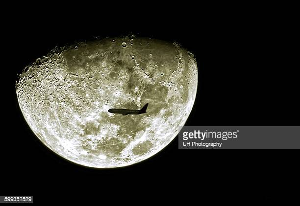 Airplane in front of moon