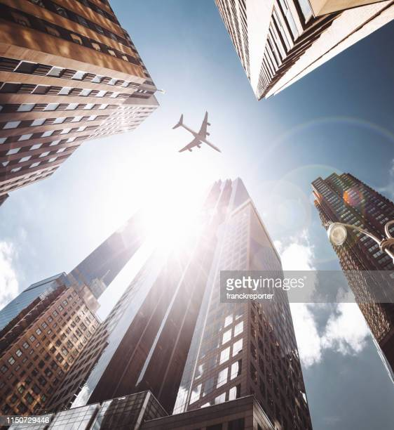 airplane in nyc - below stock pictures, royalty-free photos & images