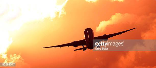 Airplane in the sunset.