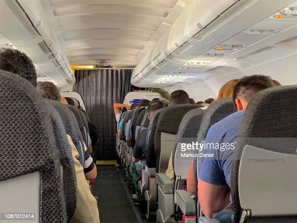 Airplane interior Isle with passengers