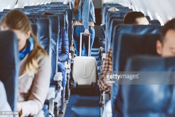 Airplane interior with people sitting on seats