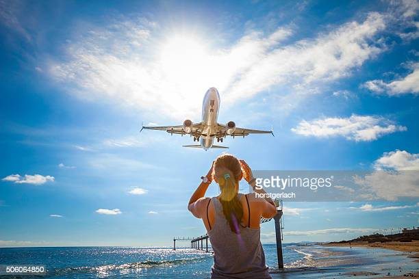 airplane landing at lanzarote airport - arrecife stock photos and pictures