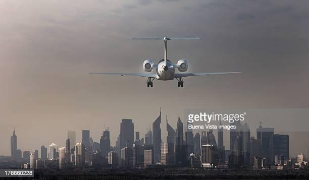 airplane landing in a futuristic city