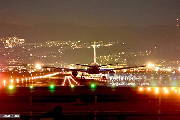 Airplane Landing On Illuminated Runway