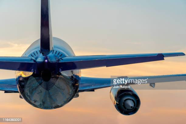 airplane landing on the runway.the site where took the photo is very far to ariport. - chonburi province stock pictures, royalty-free photos & images
