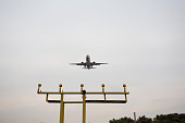 Airplane landing on the runway.The site where took the photo  is very far to ariport. Using the Telephoto lens.