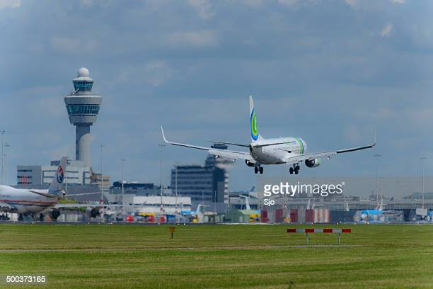 airplane landing - schiphol airport stock photos and pictures