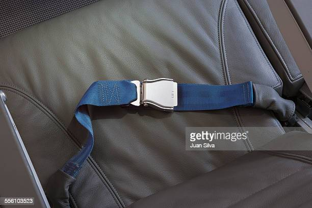Airplane leather seat with seatbelt buckled