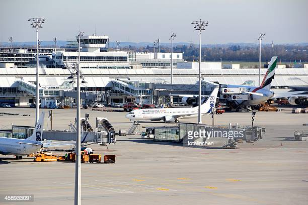 airplane loading at airport munich - munich airport stock photos and pictures