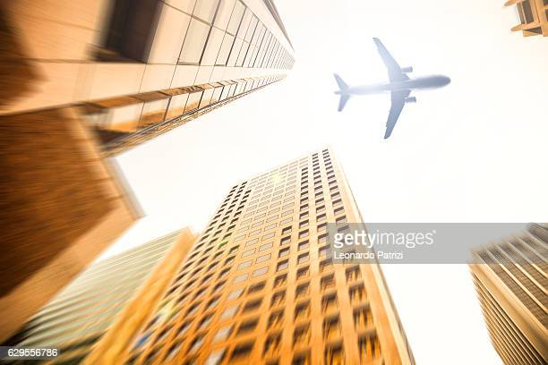 Airplane low pass over the business district