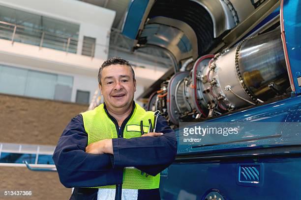 Airplane mechanic working at the hangar
