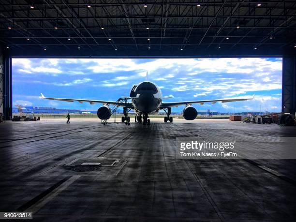 Airplane On Airport Hanger Against Sky