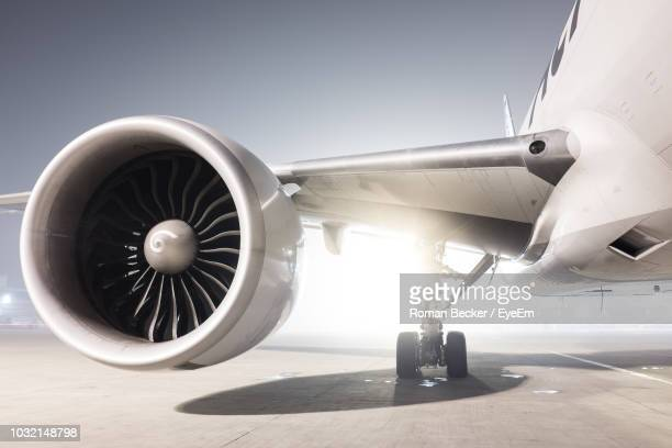 airplane on airport runway against sky - aircraft wing stock pictures, royalty-free photos & images