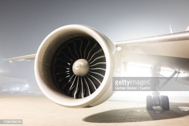 airplane on runway against sky - jet engine stock photos and pictures